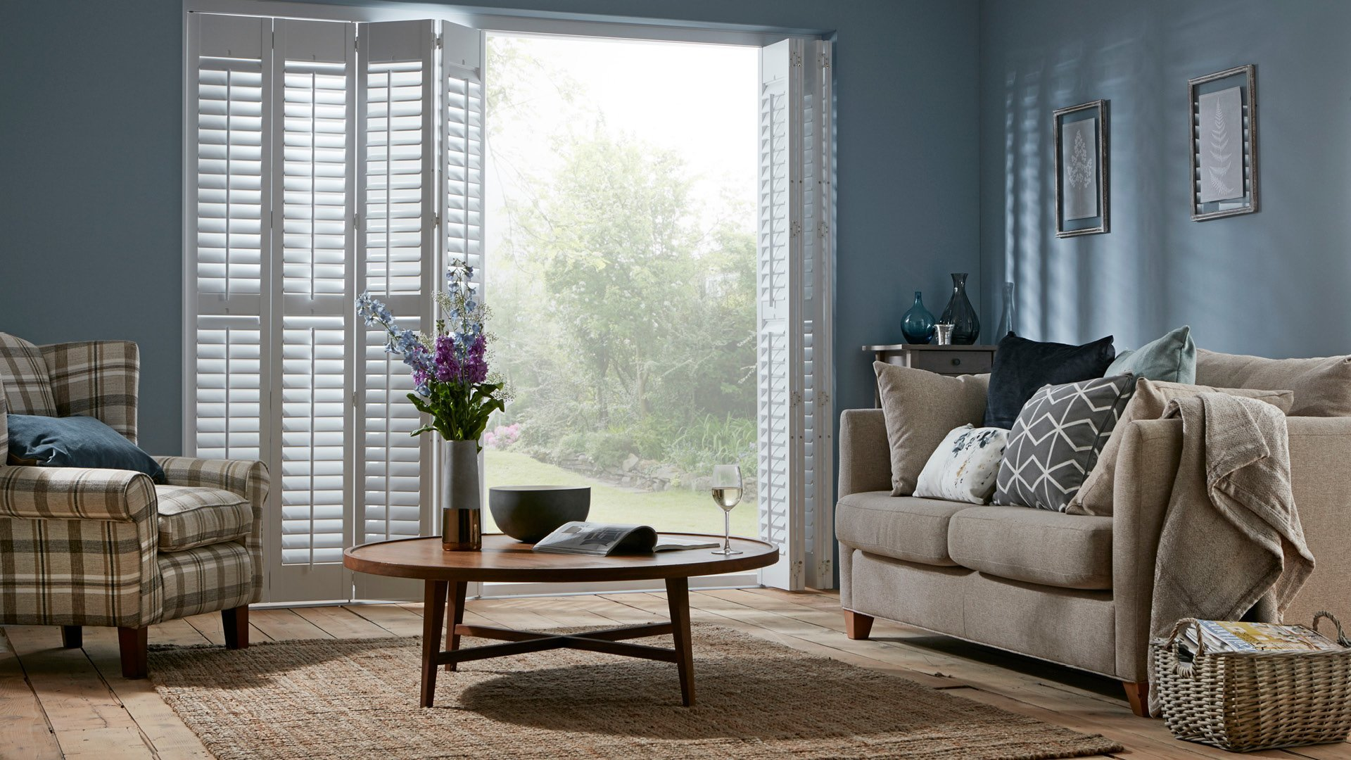 Full height tracked shutters open from Shutterstyle